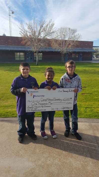 Michael, Onnie, and Logan pose with the check from the Volunteers in Partnership