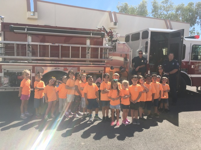 Ms. Feria's class posing with the fire engine :)