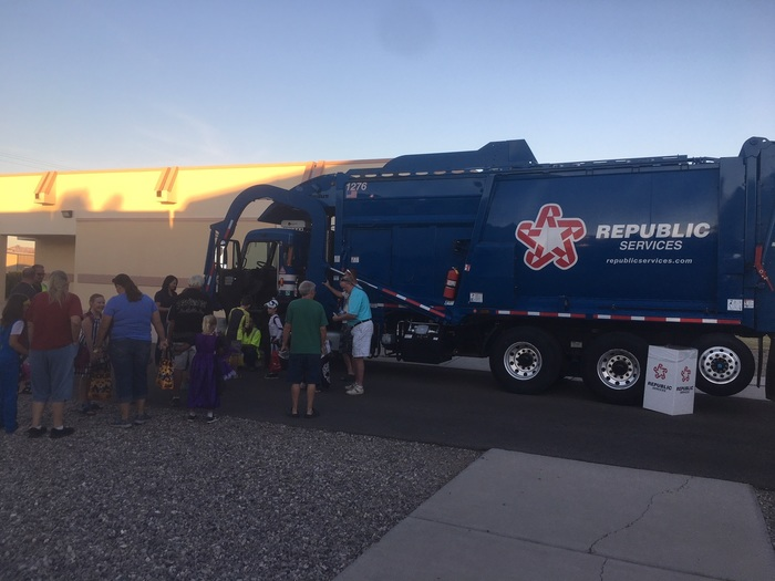 Our kids inspecting a garbage truck from Republic Services!