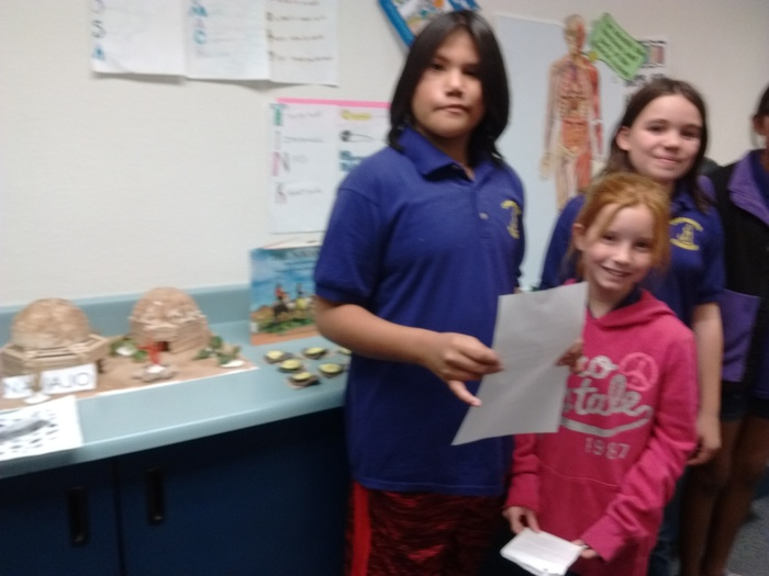 Carmalita, Alison, and Dora prepare to discuss their Native American Project on the Navaho.